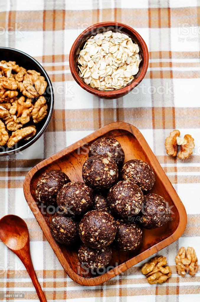 Dates cocoa coconut oats walnuts raw vegan balls stock photo