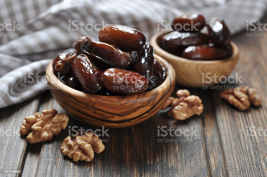 Dates fruit in a wooden bowl stock photo