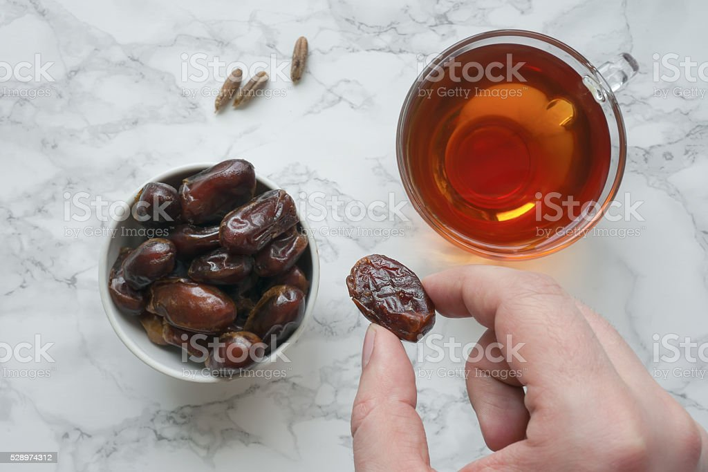 Dates fruit with cup of tea stock photo