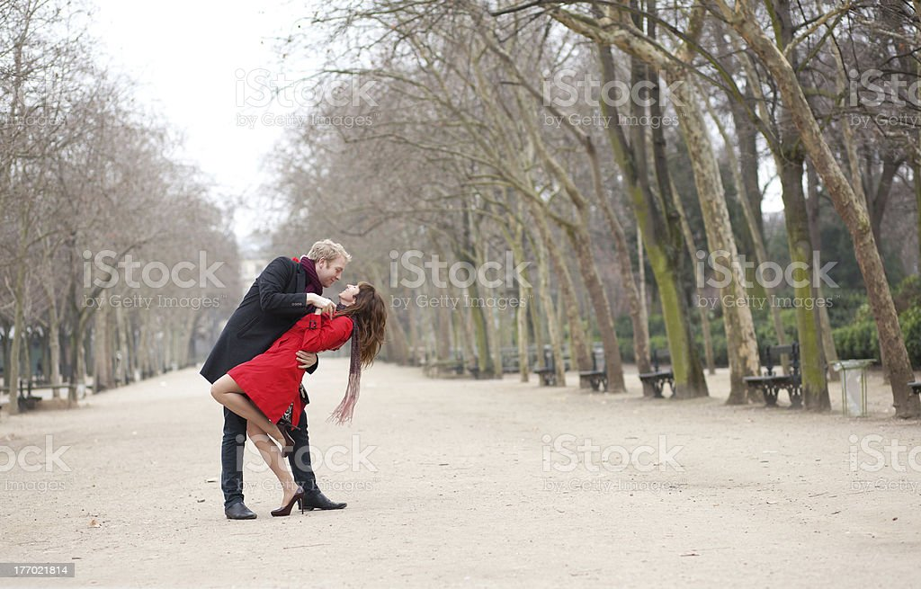 Dating couple dancing in a park royalty-free stock photo