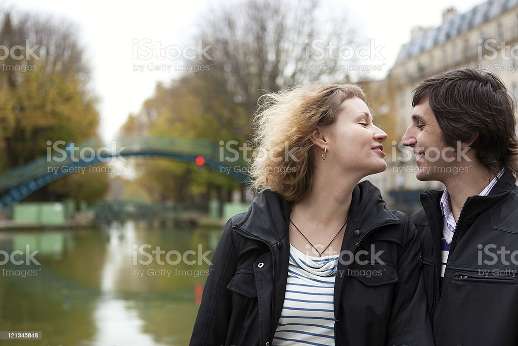 Dating couple in Paris on canal Saint-Martin stock photo