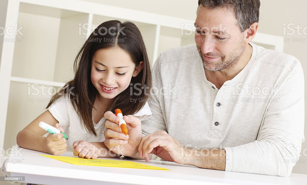 Daughter and father doing homework royalty-free stock photo