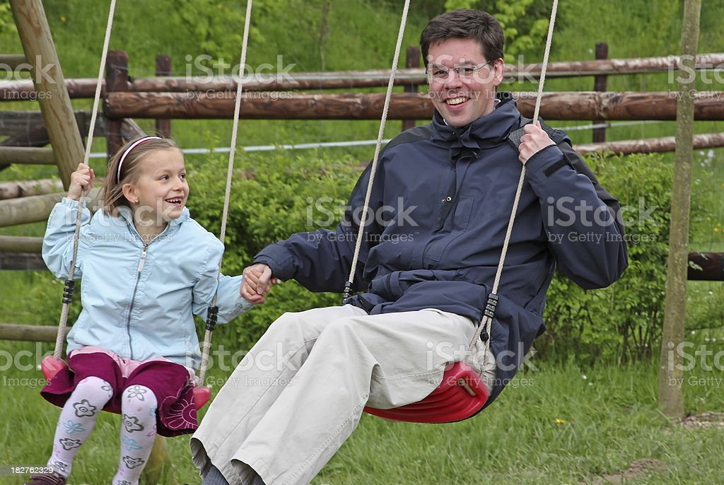 Daughter and father on the playground royalty-free stock photo