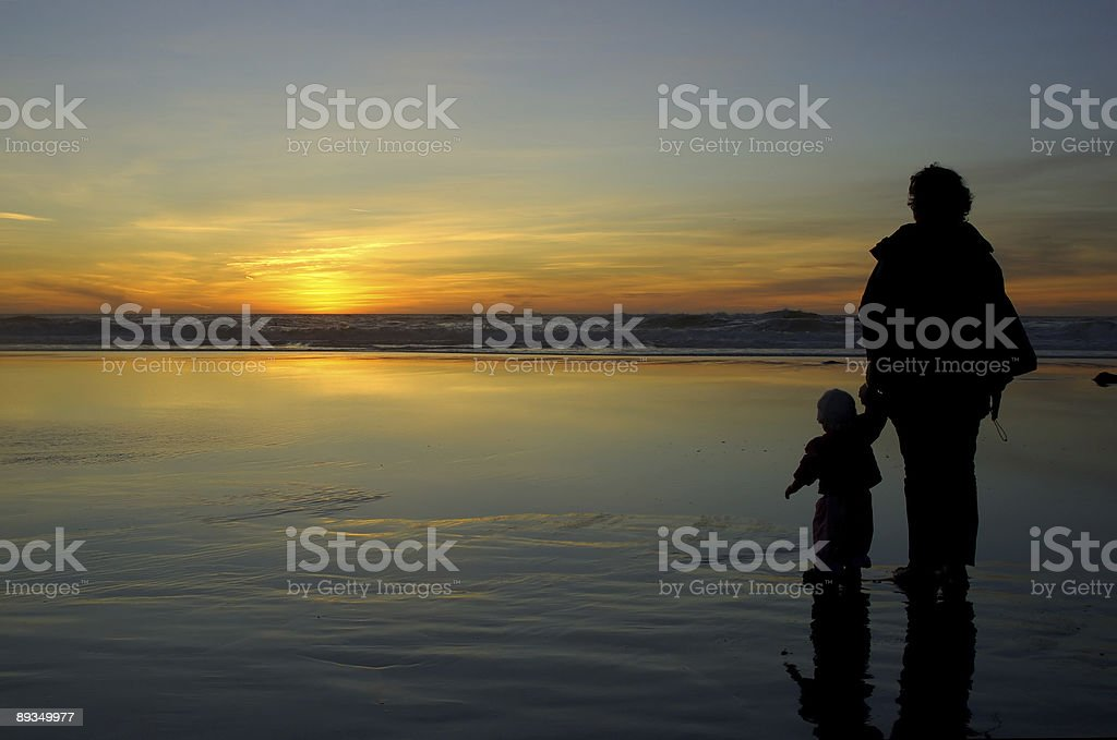 Daughter and mother at Pacific Sunset royalty-free stock photo