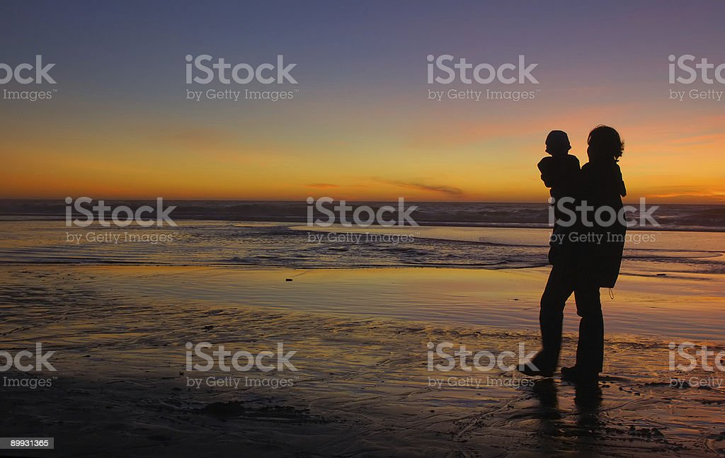 Daughter and mother at sunset 1 royalty-free stock photo