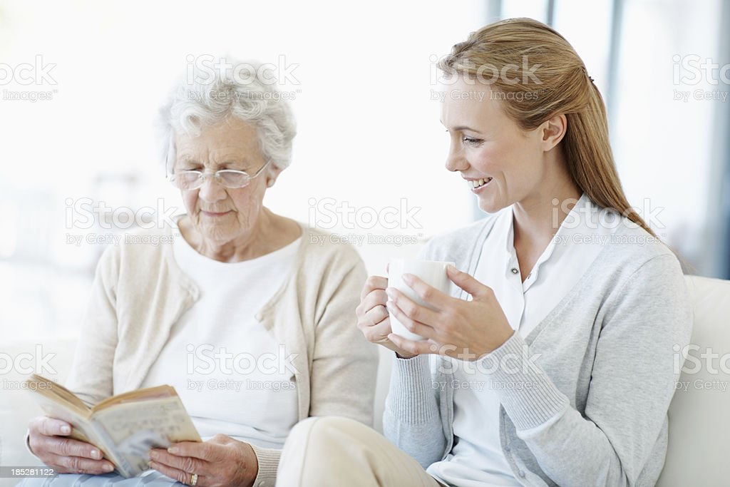 Daughter and mother bond over tea royalty-free stock photo