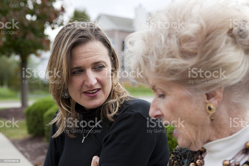 Daughter and Mother having a discussion outdoors royalty-free stock photo