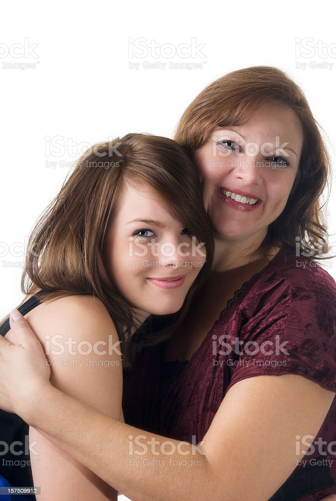 Daughter and mother hugging on white background stock photo