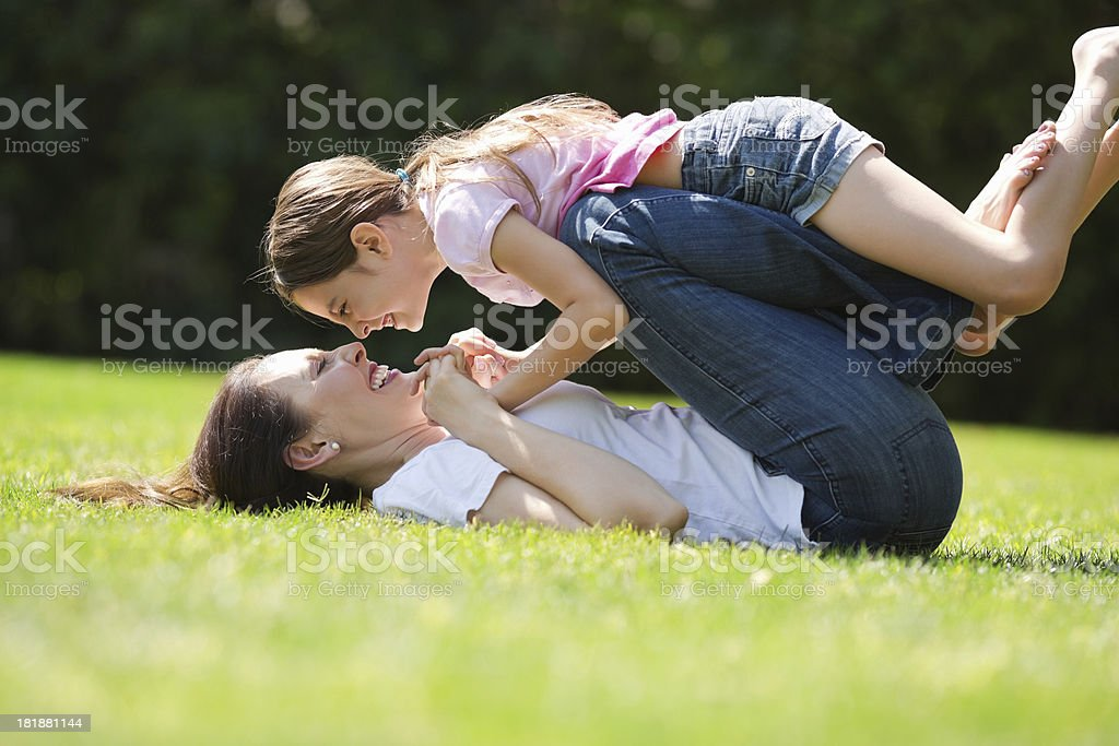Daughter And Mother Playing In Park royalty-free stock photo