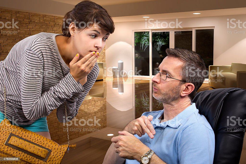 Daughter Coming Home Late At Night Past Curfew stock photo