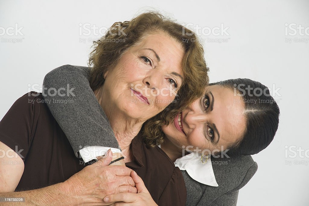 Daughter hugging and leaning on her mother royalty-free stock photo