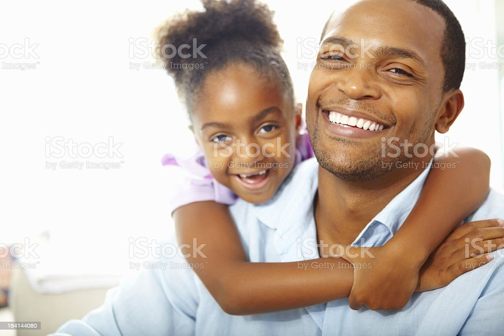 Daughter hugging her father royalty-free stock photo