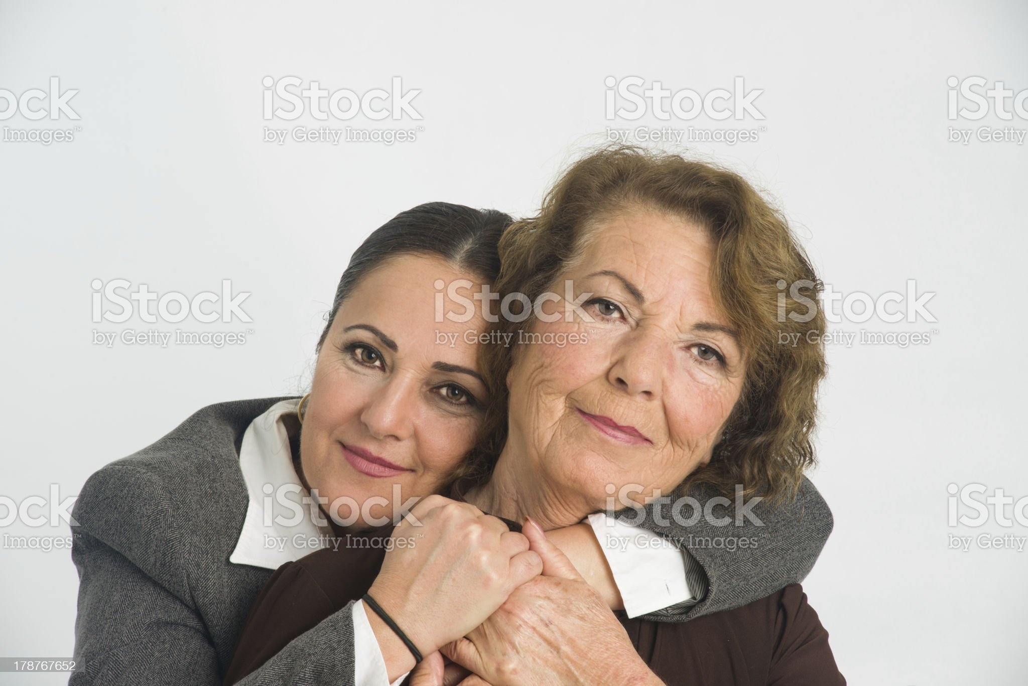 Daughter hugging her parent royalty-free stock photo