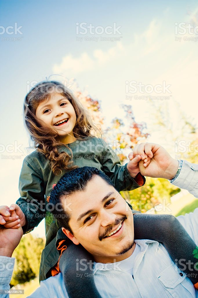 Daughter on Father's Shoulders royalty-free stock photo