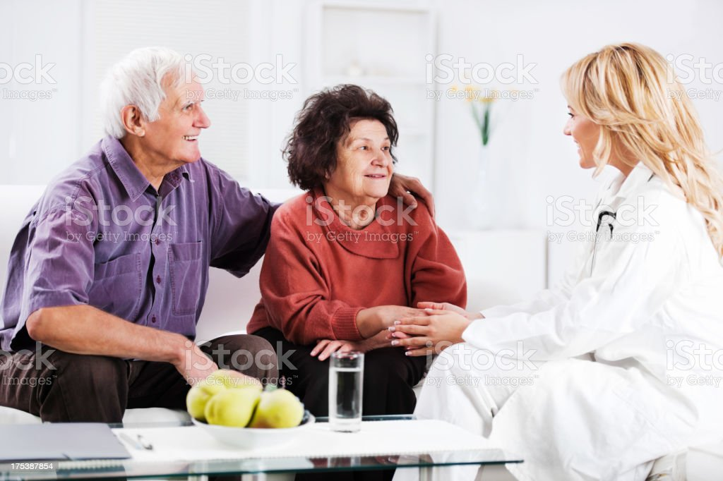 Daughter talking to her elderly parents. royalty-free stock photo
