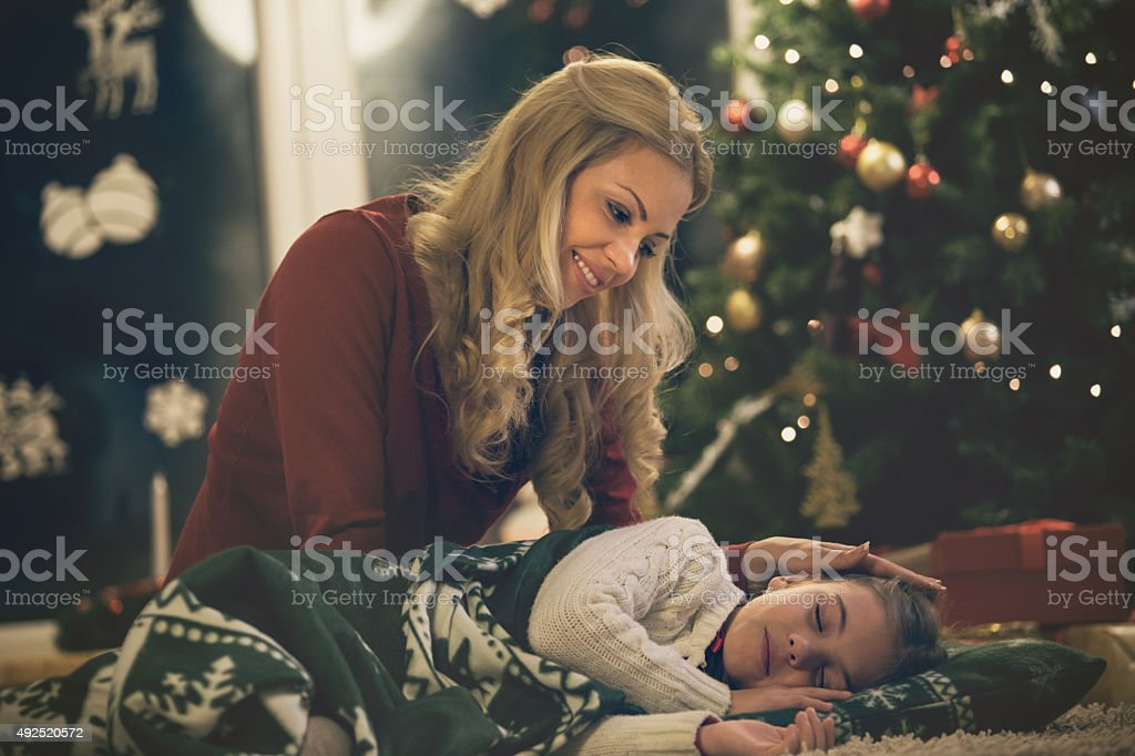 Daughter waiting for Santa, sleeping on the floor stock photo