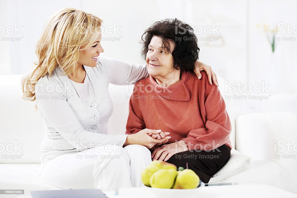 Daughter with her senior mother. royalty-free stock photo