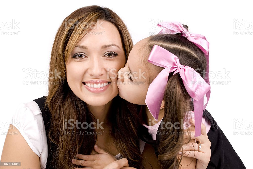 Daughters Kisses her Mother royalty-free stock photo