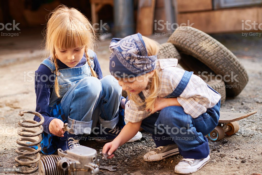 Daughters of technician stock photo