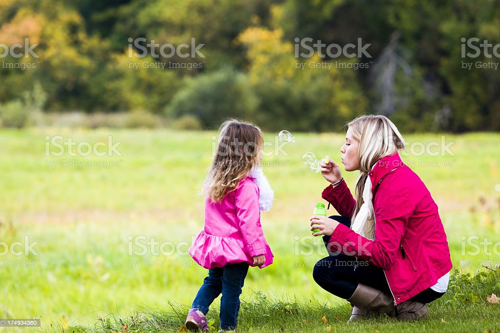 daugther and mom making bubbles royalty-free stock photo