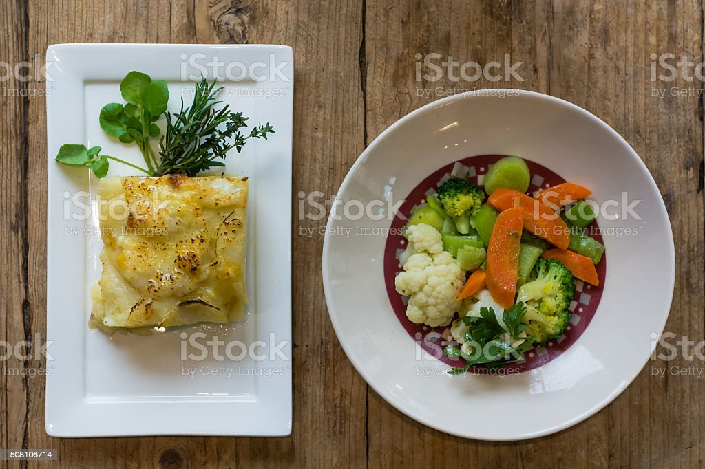 Dauphinois potato with steamed vegetables, from above stock photo