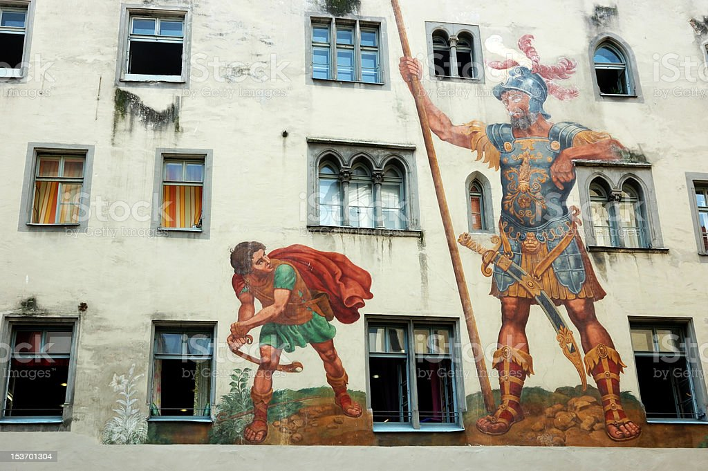 David and Goliath on the house wall ,Regensburg,unesco heritage stock photo