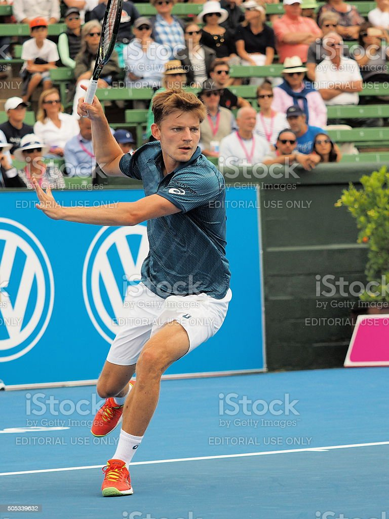 David Goffin of Belgium runs for a forehand stock photo