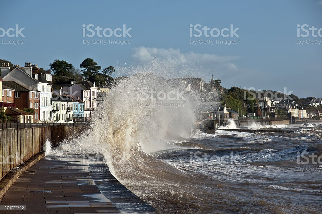 Dawlish by the railway at very high tide stock photo