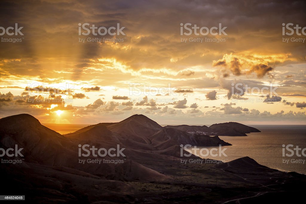 Dawn above mountians and sea stock photo