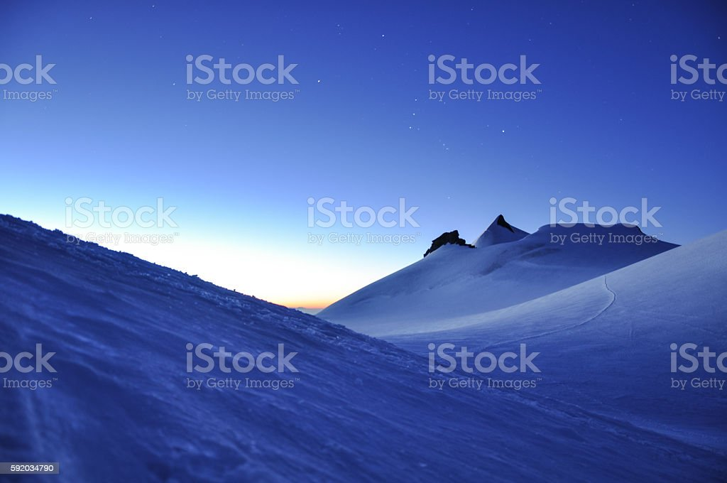 Dawn at high altitude in Swiss Wallis Alps stock photo