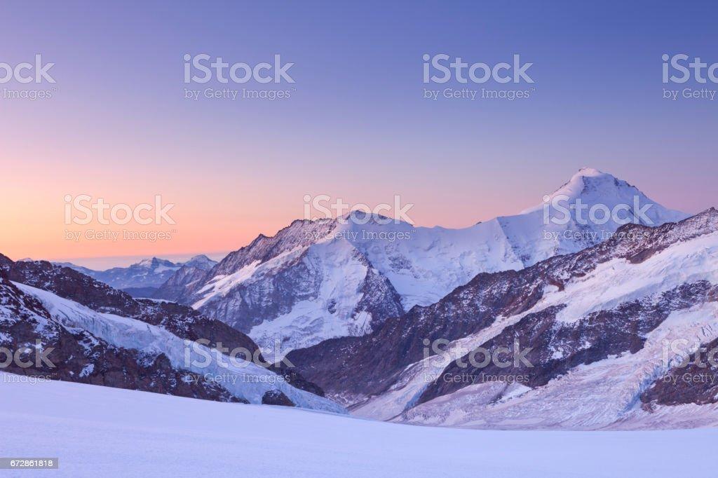 Dawn at Jungfraujoch in Switzerland stock photo