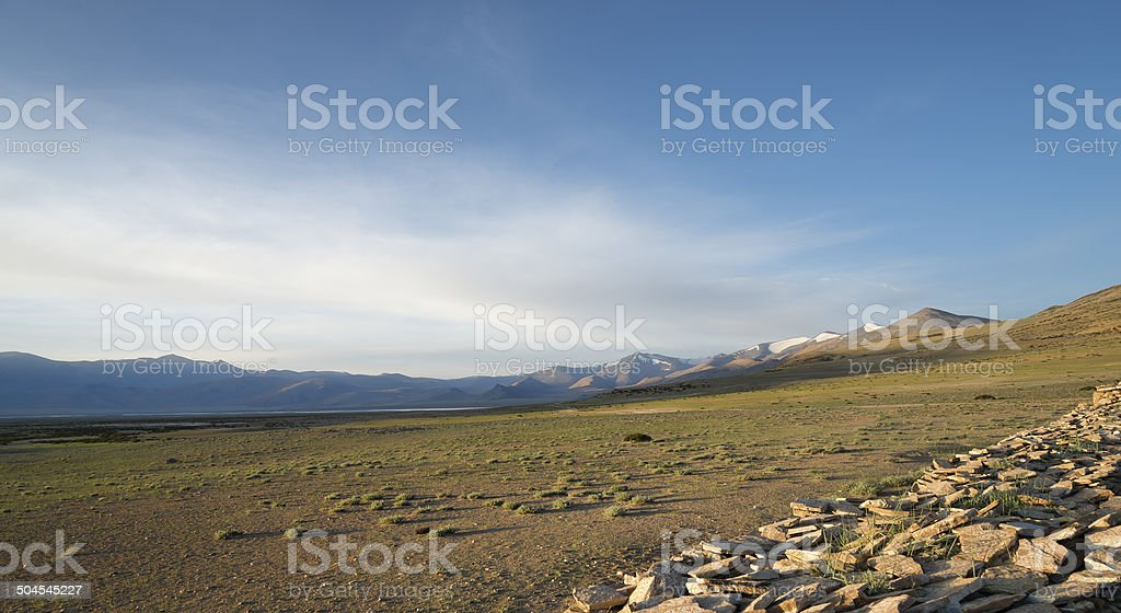 Dawn at mountain lake and buddhist monument royalty-free stock photo