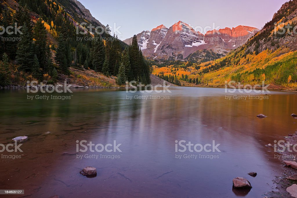 Dawn at the Maroon Bells in Fall royalty-free stock photo