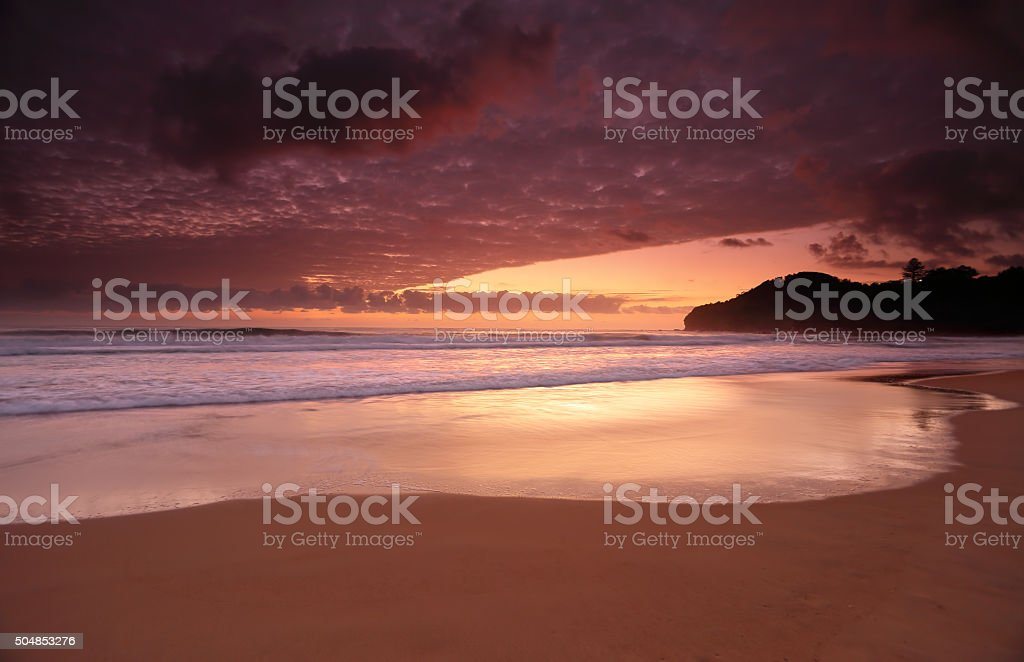 Dawn colours at Warriewood Beach stock photo