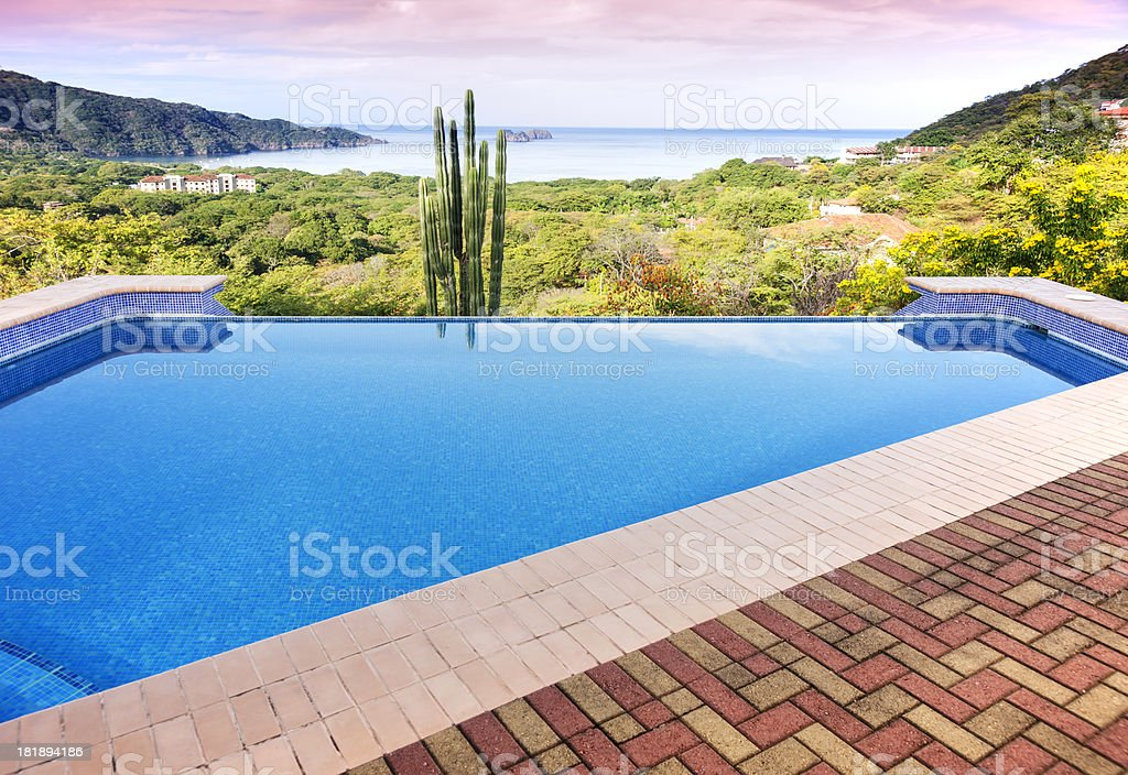Dawn from a patio overlooking the ocean royalty-free stock photo
