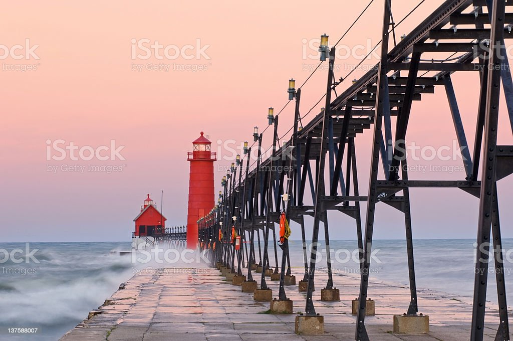 Dawn Grand Haven Lighthouse stock photo