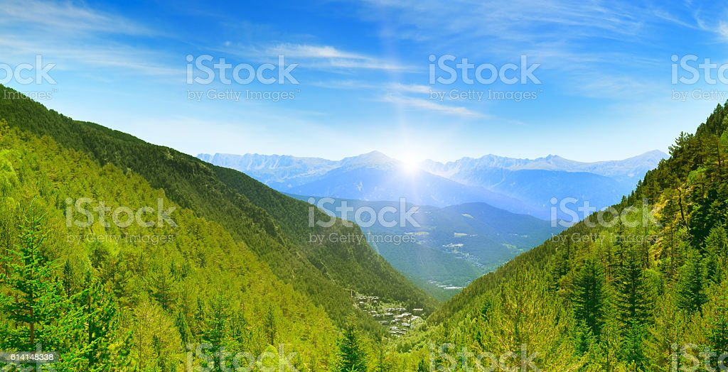 Dawn in the picturesque mountains covered with forests. stock photo