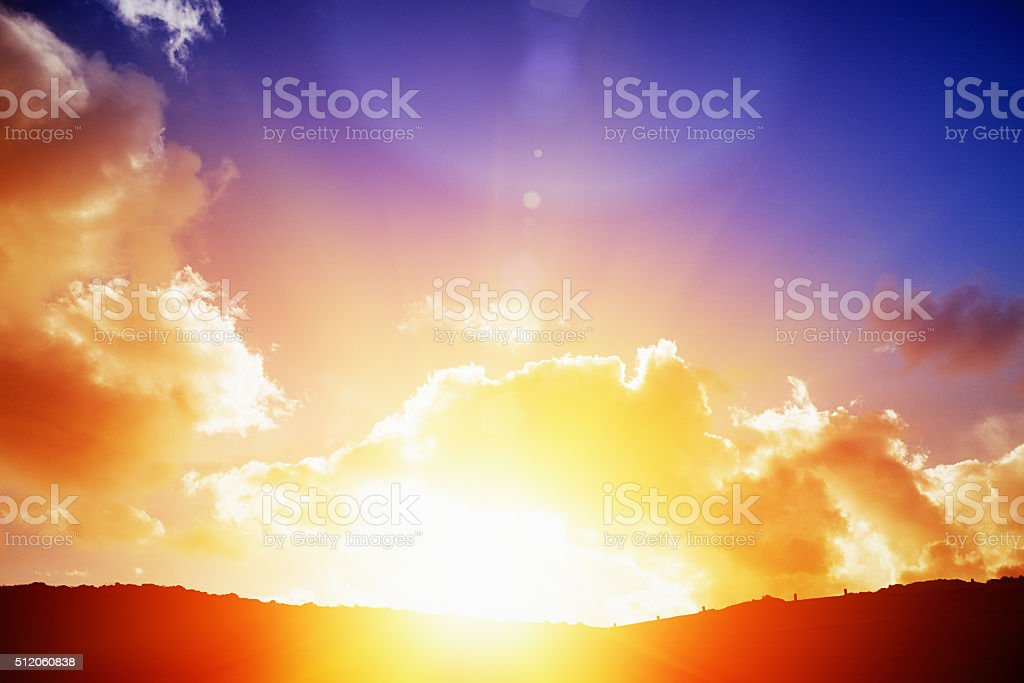 Dawn of a new day: golden sun rising over horizon stock photo