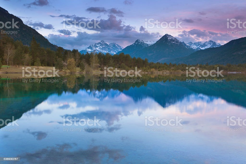 dawn on a small lake, tirol, austria stock photo