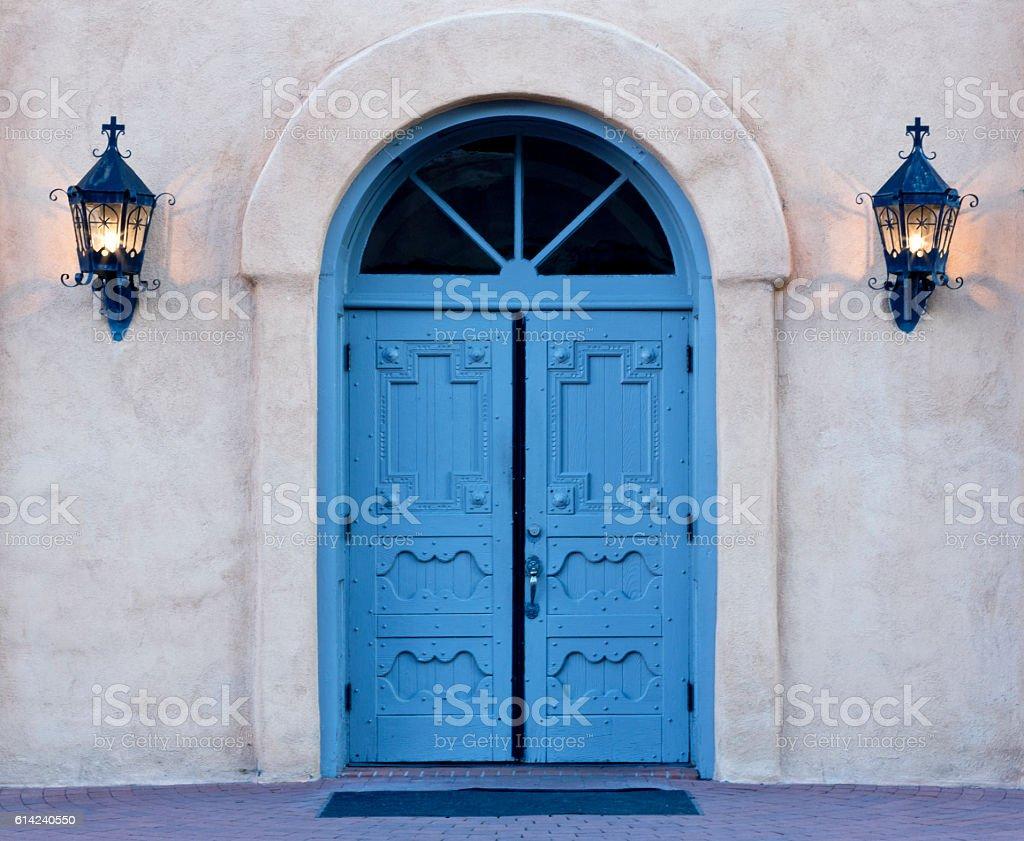 Dawn on blue doors of Albuquerque church stock photo