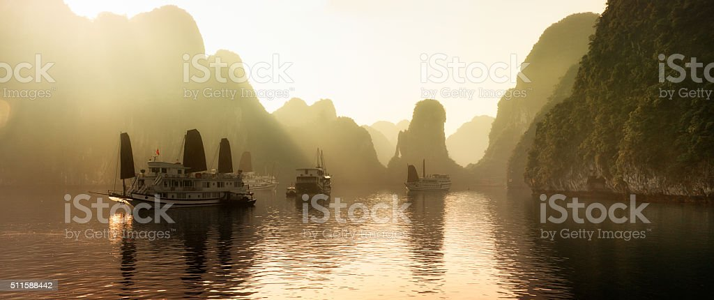 Dawn on Halong Bay, Vietnam with mist panorama stock photo