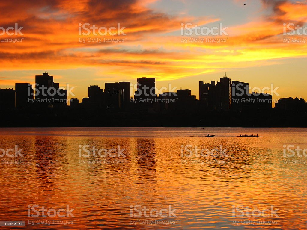 Dawn on the Charles, city's asleep but rowers are out stock photo
