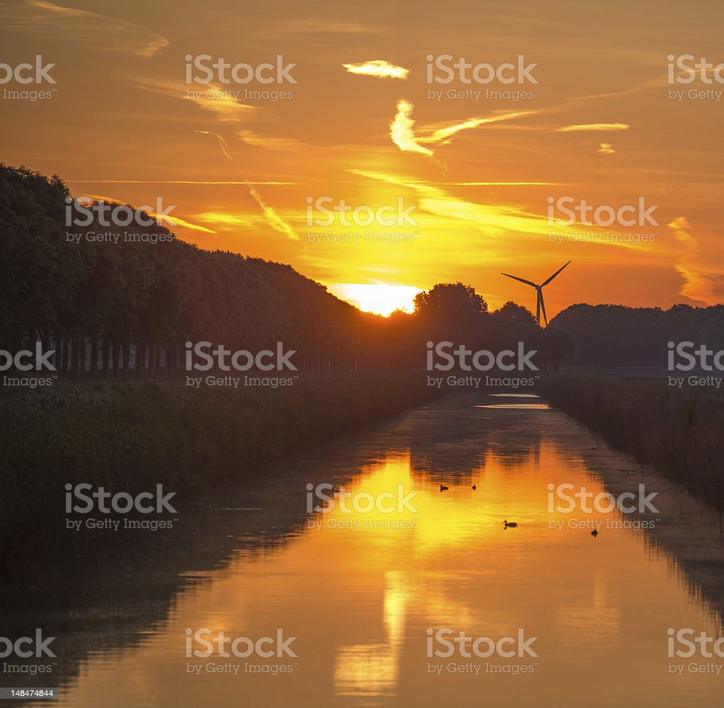 Dawn over a canal in spring royalty-free stock photo