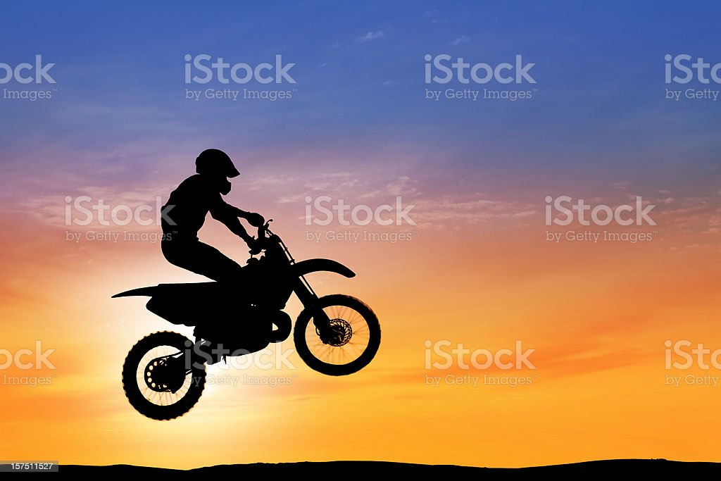 Dawn over flying motorbike royalty-free stock photo