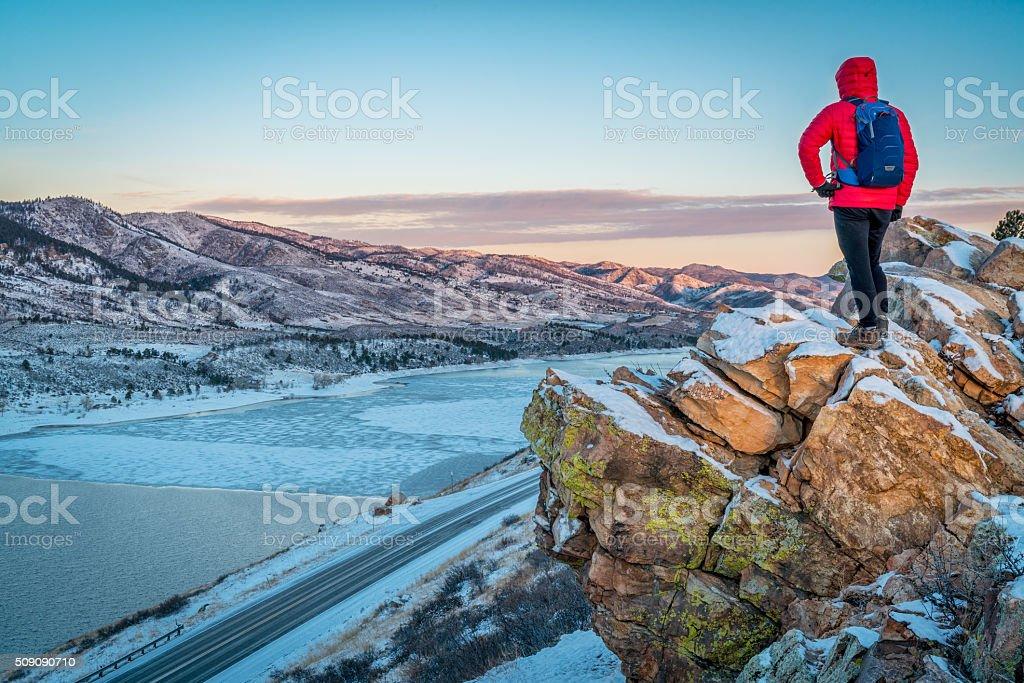 dawn over frozen mountain lake stock photo