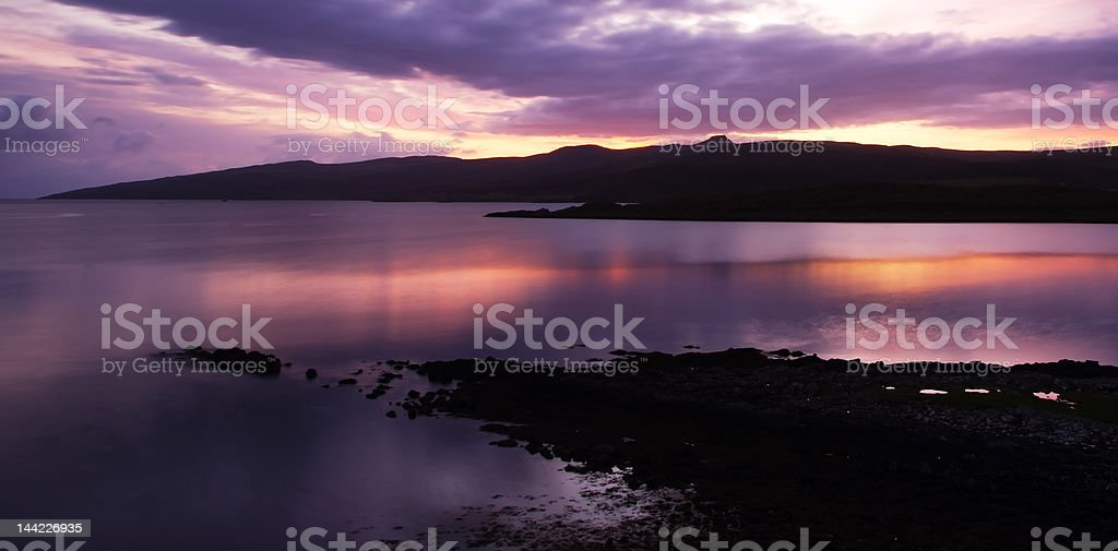Dawn over Loch Sligachan to distant misty mountains stock photo