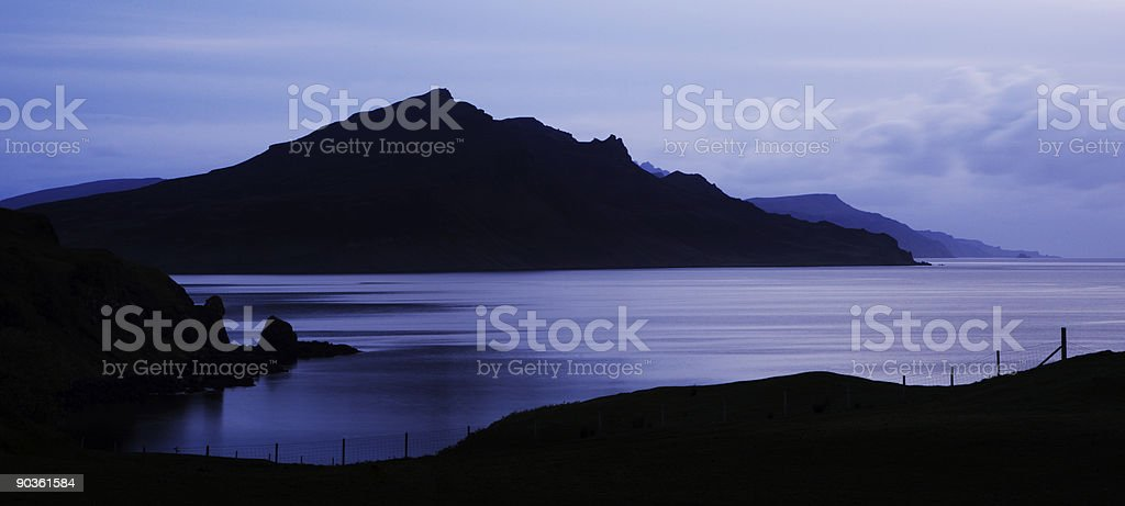 Dawn over Loch Sligachan to distant misty mountains royalty-free stock photo