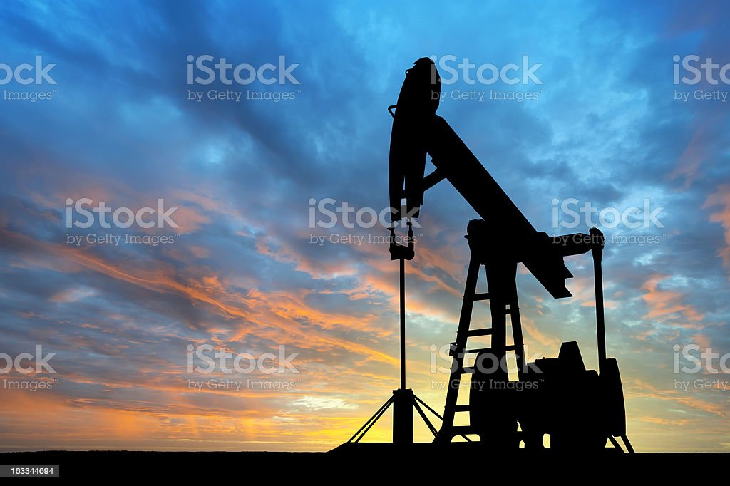 Dawn over petroleum pump stock photo