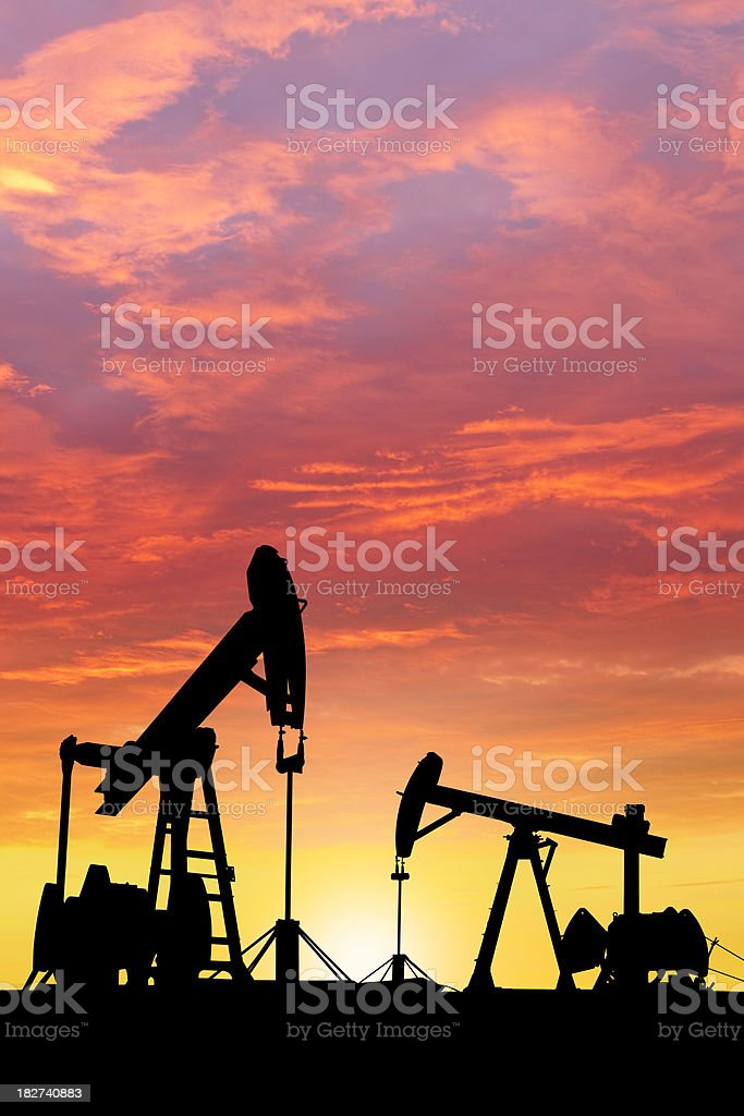 Dawn over petroleum pumps in the desert royalty-free stock photo