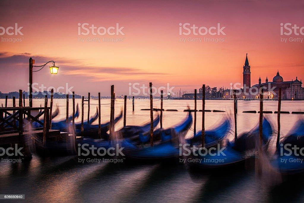 Dawn over the Gondolas of Venice stock photo